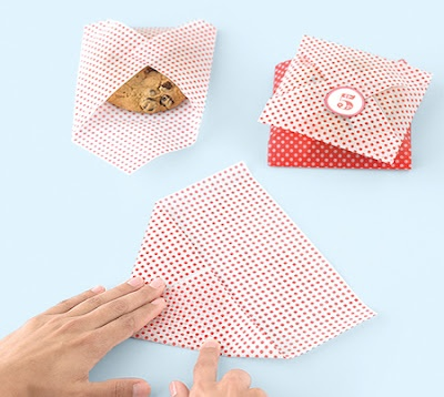 Cookie Packaging. Another easy DIY paper craft packaging for gifts from the kitchen idea for single cookie. Wrap cookie in wax paper first and then add it to the handmade envelope of pretty paper.