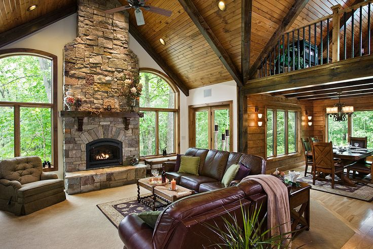 great room interior with beautifully stained beams and tongue and groove, Timberhaven Log Homes, log home, log cabins, log cabin kits, post and beam homes, under construction, kiln dried, laminated
