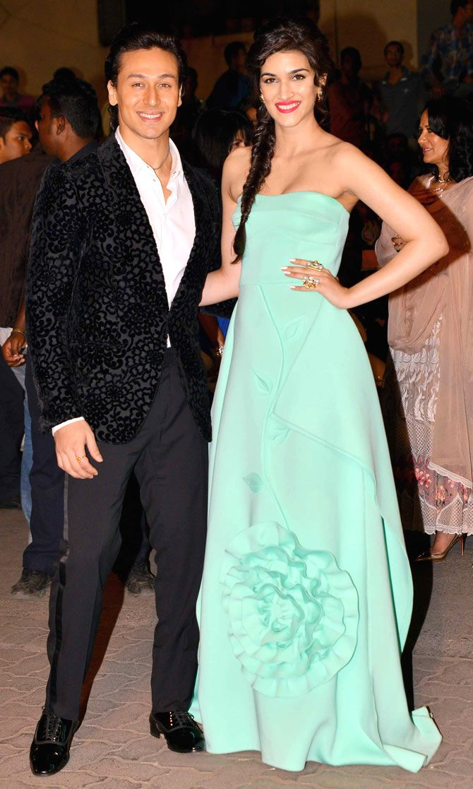 Tiger Shroff with Kriti Sanon arriving at the 60th Filmfare Awards 2014