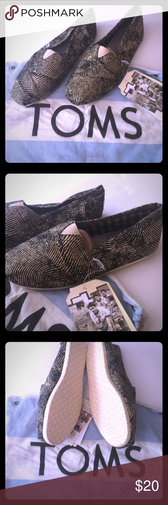 NWT TOMS Classic Fingerprint Shoes New with tags Womens TOMS Classic Organic Cotton Fingerprint Black Casual Slip On Shoes. Toms Shoes