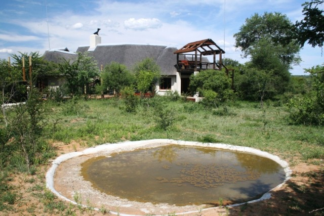 Water hole and house