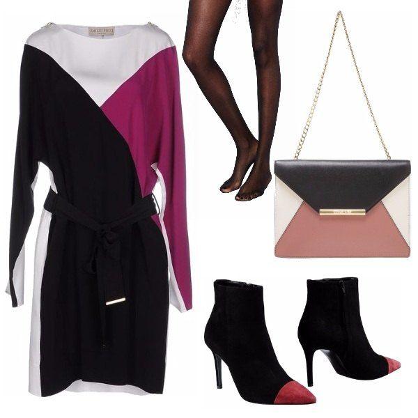 Nero e bordeaux: abbinamento classico e chic. L'abito ha una linea morbida che scivola comoda sulle rotondità, aiutato anche dal gioco di curve dei colori. Boots e borsetta con catena richiamano le tonalità avvolgenti e del vestito.