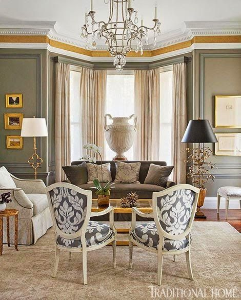 beautiful traditional taupe gray white living room with gilt gold accents black white chairs