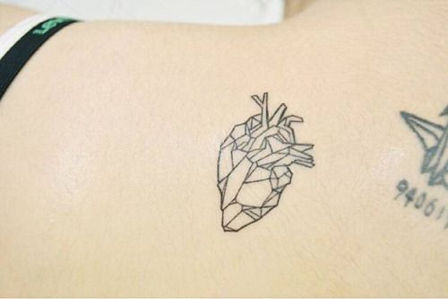 Little polygon heart on the upper back. Tattoo artist: Banul