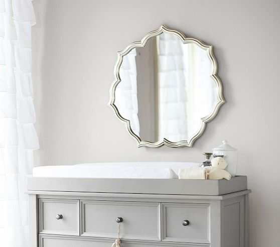 A pretty and classic mirror for above the changing table.