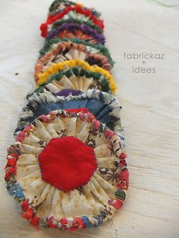 Fabric yoyos with added cloth strips sew around the edge.