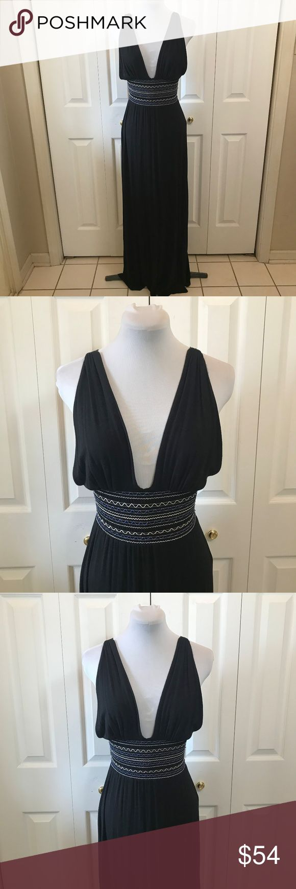 """Aqua Black Maxi Dress sz M from Bloomingdales Aqua Black Maxi Dress sz M from Bloomingdales Cross Over Back Measurements are an approximation as its very hard to measure this style accurately Bust: 26"""" Elastic Waist: 20"""" unstretched Hip: 40"""" Length: 62"""" Aqua Dresses Maxi"""