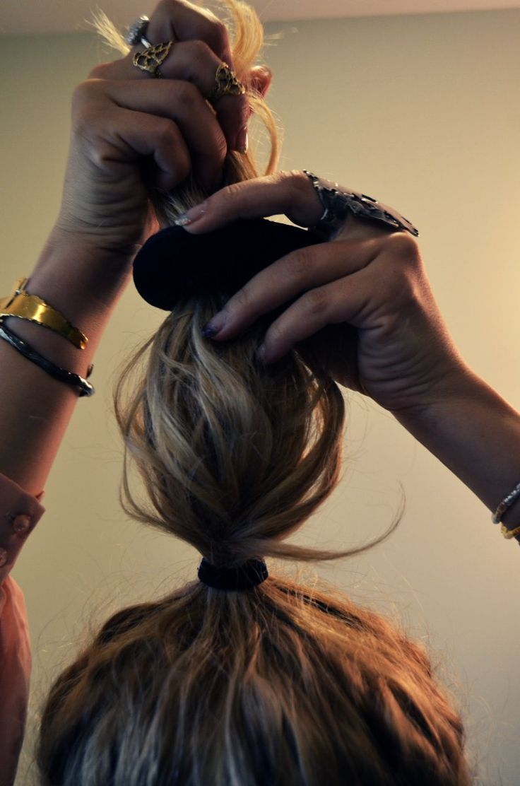 5 simple steps to turn your solo sock into a DIY Sock Bun! All you need is a sock, an elastic and a pair of scissors.