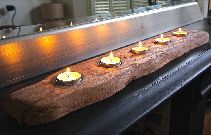 Perfect for the dining table, this stunning driftwood log tealight holder holds either 3, 5 or 7 candles . £39.95