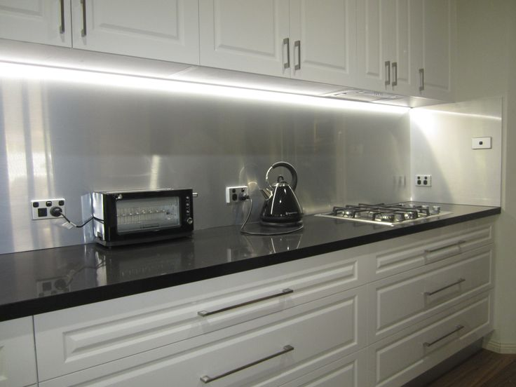 Have a look at the  brushed aluminium splashback we installed in a white kitchen?  The black appliances and stove really offset the splashback complimenting the entire kitchen.