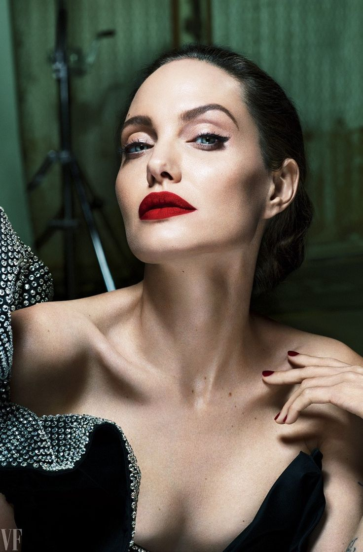 Angelina Jolie stuns with dark red lipstick