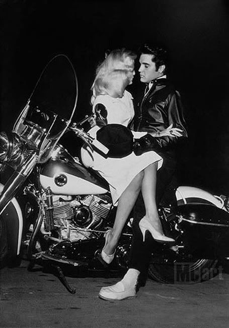 Smooth Elvis Presley and a date on his Harley.