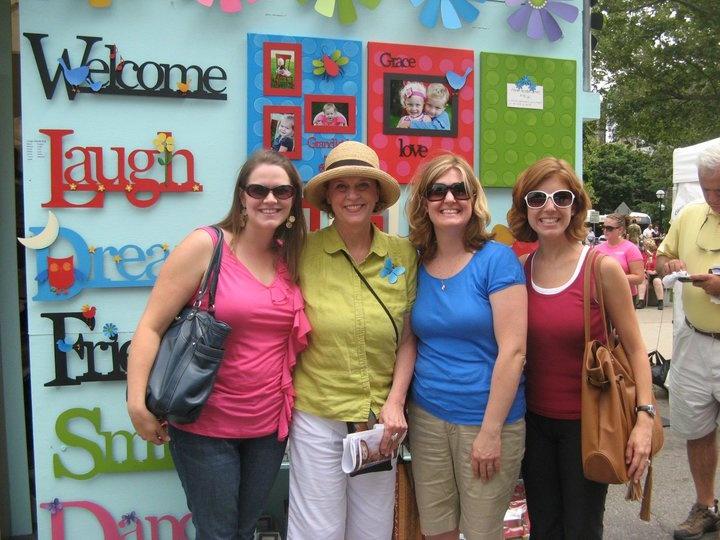 Carol, with fans at her Ann Arbor Art Fair booth.