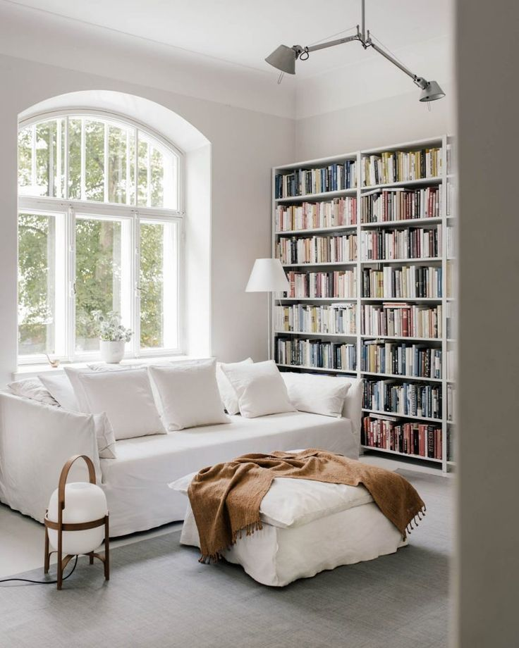 White living room with linen slipcovers