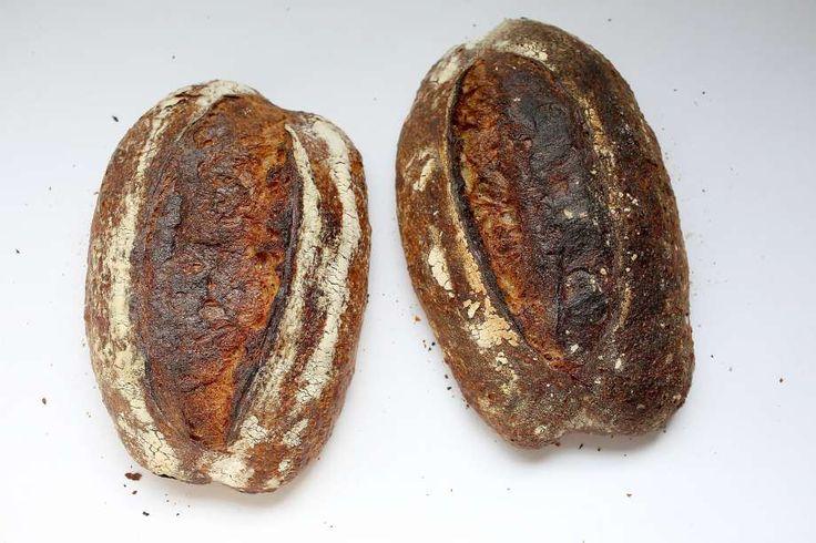 Tartine country bread (left) and Pain walnut bread (right). Photo: Liz Hafalia, The Chronicle