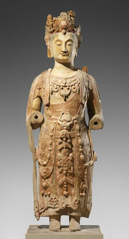 Bodhisattva, probably Avalokiteshvara (Guanyin), ca. 550–560, Northern Qi dynasty (550–577). Sandstone with pigment. H. 13 ft. 9 in. (419.1 cm); H. with base 14 ft. 9 in. (449.6 cm). The Sackler Collections, Purchase, The Sackler Fund, 1965, 65.29.4 © 2000–2016 The Metropolitan Museum of Art