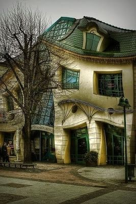 "The crooked house in Sopot, Poland has an extraordinary and amazing structure. It was built in 2003 with design based on the pictures of Jan Marcin Szancer and Per Dahlberg. It looks as taken from a cartoon movie, its design is ""crooked"", but a kind of symmetrically, so it is not ugly at all, just strange! The interesting part is how builders managed to create this genius idea, but the house is a fact and everyone admires their creativity."