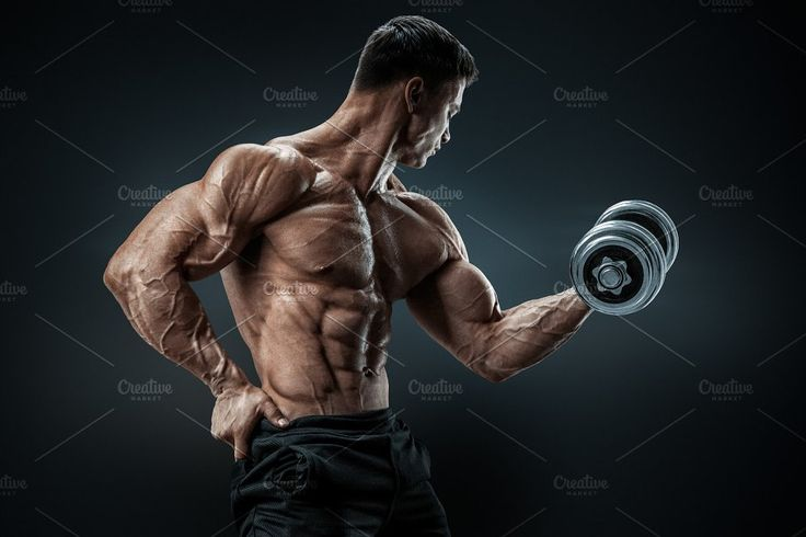 Male bodybuilder in training by Usmanov Stock Photography on @creativemarket