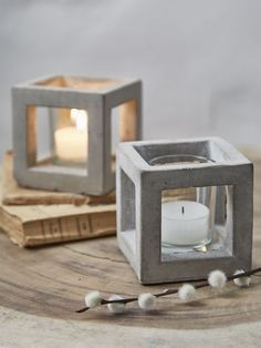 These contemporary concrete tealight holders will …