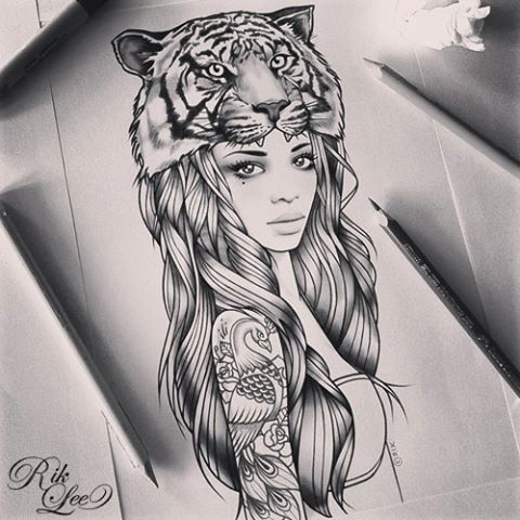 Rik lee.  I Love that she has a tattoo.  Instead of the tigers head, maybe an elephant?  I like it.