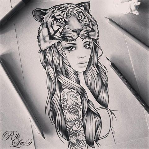 Rik lee. I Love that she has a tattoo. Instead of the tigers head, maybe an elephant? I like it.