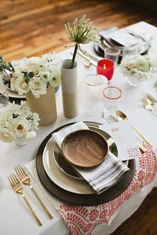 modern mexicana tablescape with varied textures, embroidery, stone, wood, gold. I would love to see some succulents or traditional mexican wildflowers instead of white roses and white anemones and rannunculus.