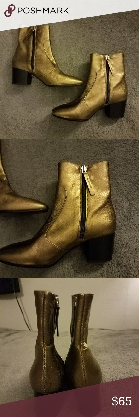 BRAND NEW Topshop Gold Metallic Heel Ankle Boot Brand new never worn!! Topshop gold metallic ankle boots. Zipper closure on sides and black heel. Size 37 from Topshop which is equal to a size 6.5 in US according to their websites size chart. Image for reference shown. Topshop Shoes Ankle Boots & Booties