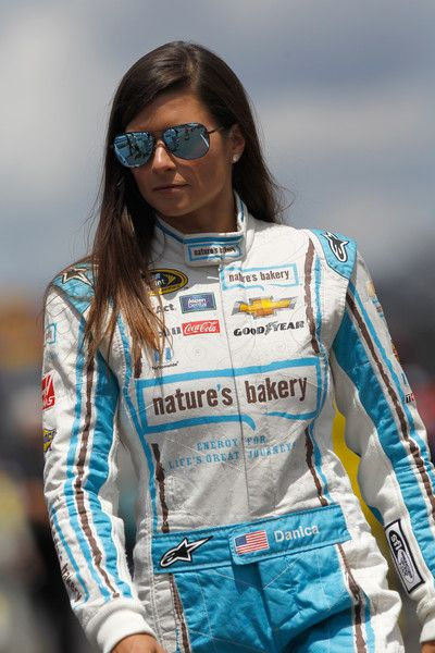 Danica Patrick Photos - Danica Patrick, driver of the #10 Nature's Bakery Chevrolet, walks on the grid during qualifying for the NASCAR Sprint Cup Series Crown Royal Presents The Combat Wounded Coalition 400 at Indianapolis Motor Speedway on July 23, 2016 in Indianapolis, Indiana. - Indianapolis Motor Speedway - Day 2