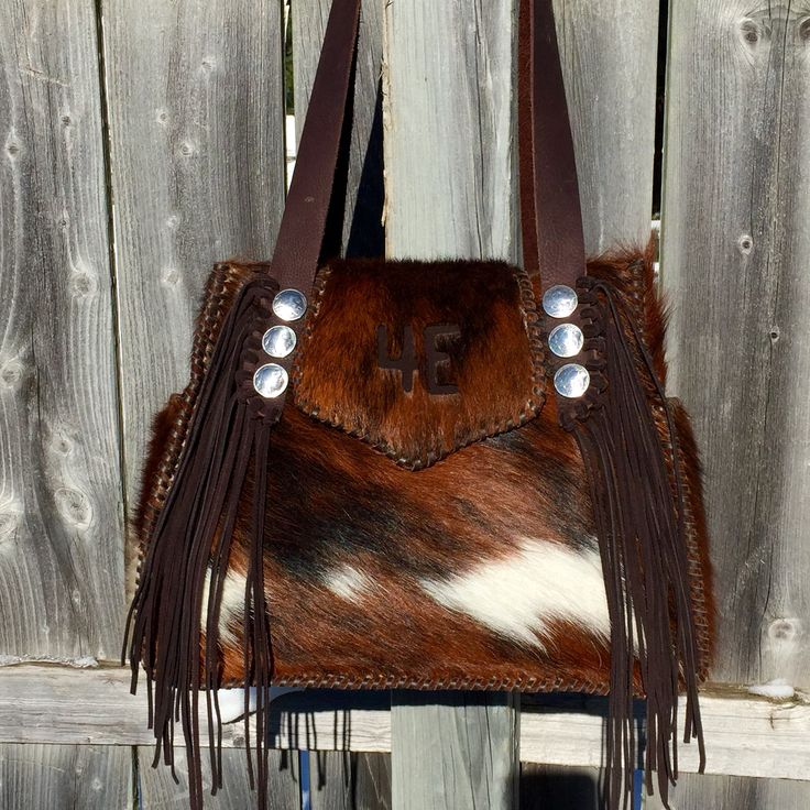 A Bonnie Bag with exterior side pockets and the owner's brand. From gowestdesigns.us