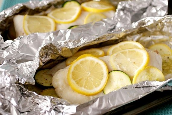 Baked Alaskan Cod simply seasoned with oil, salt/pepper, lemon and fresh slices of zucchini/squash {from Sing for Your Supper...}