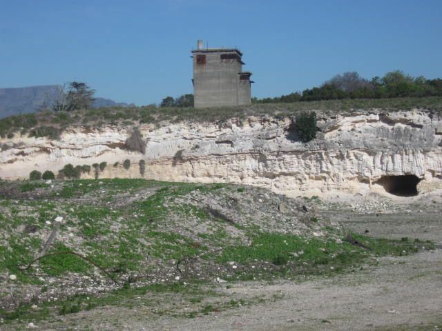 The limestone quarry when prisoners worked. The cave to the right was the only shelter from the sun, was also used as a toilet and for secret meetings during the working day.