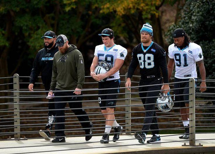 Carolina Panthers linebacker Luke Kuechly, left, tight end Greg Olsen, center and defensive end Ryan Delaire walk to practice on Wednesday, November 18, 2015 in Charlotte, NC.
