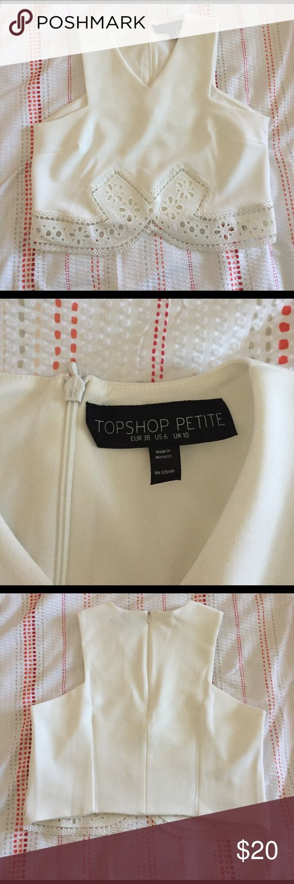 Topshop petite crop top ! TOPSHOP Petite CROP TOP! Super adorable. My boobs are just to big for it now 😩. One stain on the back side on the strap and slight foundation stain on the front Topshop PETITE Tops Crop Tops
