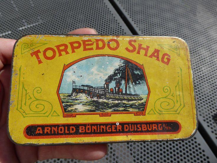 http://www.ebay.de/itm/Tabakdose-Torpedo-Shag-Arnold-Boeninger-Duisburg-a-Rh-Tobacco-Tin/382232579987?hash=item58fed64f93:g:XUsAAOSw7RdZw~57
