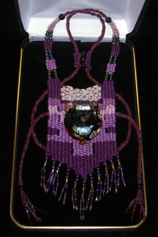 """Sugar Plum"" - 2012 - Adjustable Length, Dichroic Glass Centerpiece, SOLD. Woven by Terri Scache Harris, theravenscache.shutterfly.com Hand woven, handwoven, weaving, weave, needleweaving, pin weaving, woven necklace, fashion necklace, wearable art, fiber art."