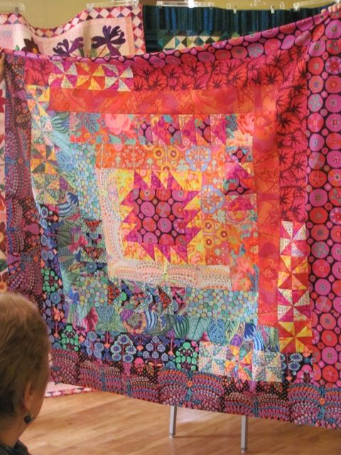 Enchanted Quilters of Lopez Island.  Very large log cabin block in Kaffe fabrics.  Colors!
