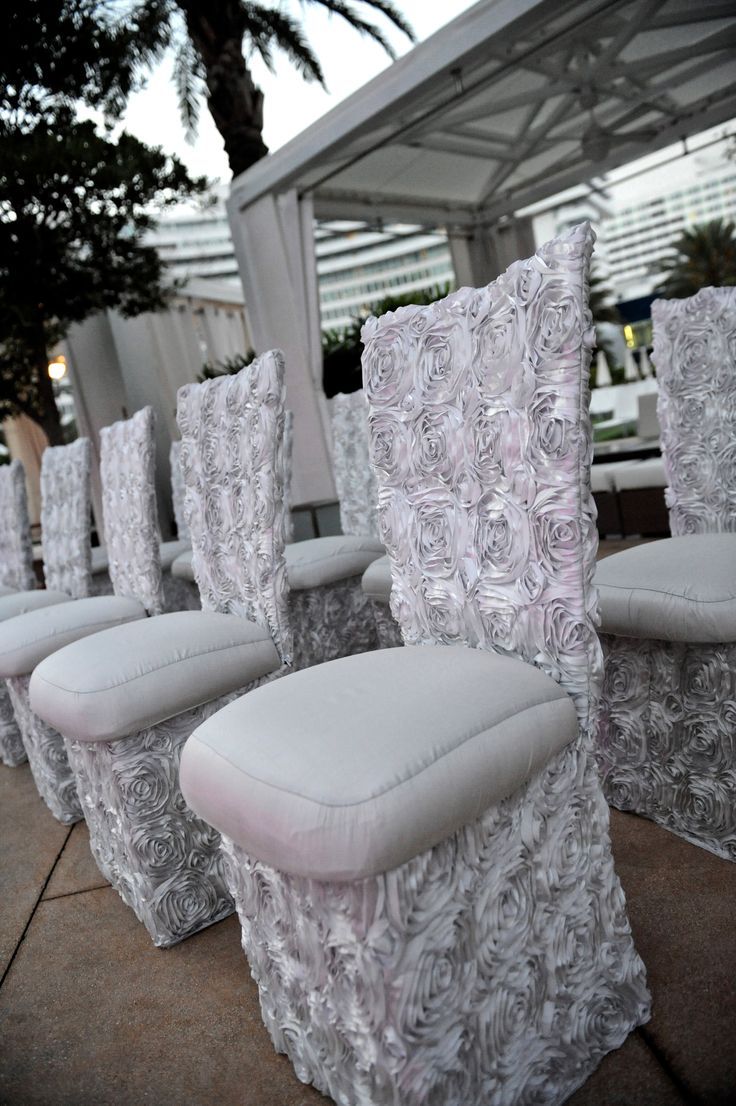 Custom silver rosette chair covers for John & Tiffany Cook's outdoor wedding ceremony. Wedding planning and design by Tiffany Cook Events