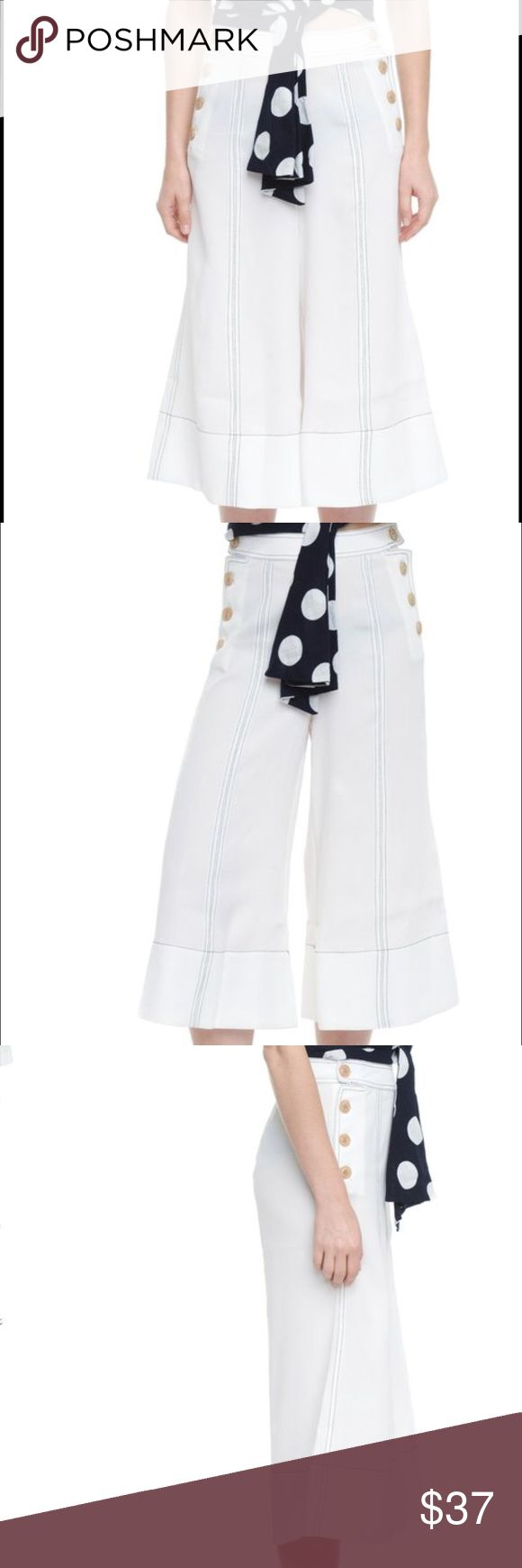 culottes style pants with contrast stitching Loose and easy midi culottes-style pants with contrast stitching. Functioning sailor-style buttons along pockets. Mid-weight fabric has a viscose texture. Fits loose and slightly below natural waist. Unlined. Style Mafia Pants Wide Leg