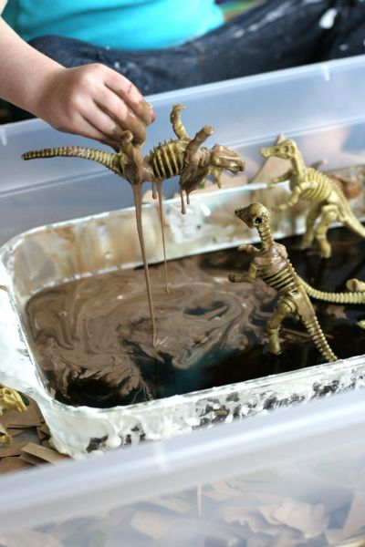 Simple Small Worlds: Dinosaurs and Sticky Mud - Sticky mud is simple to make, and the ingredients are common household staples.  Add a few dinosaurs for hours of imaginative play.  The best part is that sticky mud rinses off easily and is great for both indoor and outdoor play.
