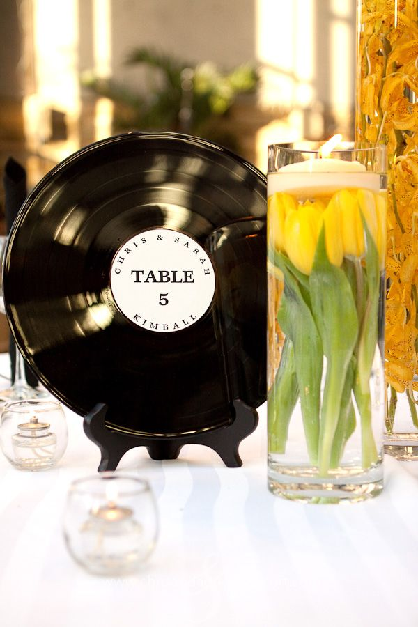 Records with the song titles instead of table #'s... Guests will rise to go to the buffet when their table's song is played :)