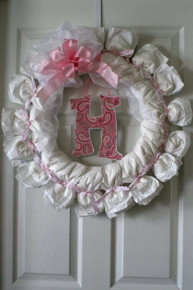 Baby Shower Diaper Wreath. Would be cute to use at the hospital!