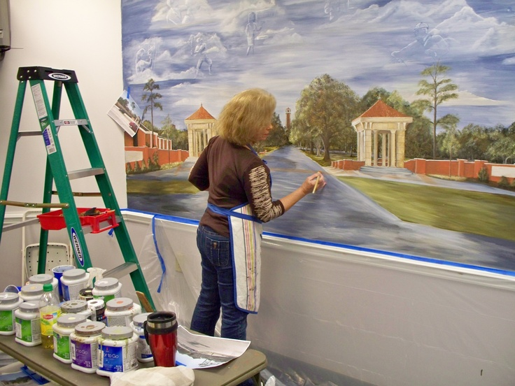 Working on painting mural for University of South Alabama