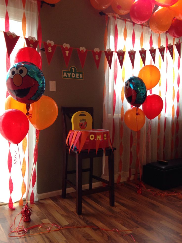 Elmo birthday party balloons decorations high chair one first birthday DIY