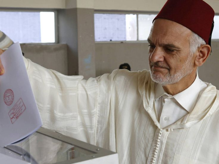 A Moroccan man casts his ballot at a polling station for the parliamentary elections in Rabat