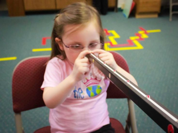 """Effective Amblyopia therapy at Wow Vision Therapy is NOT just about patching an eye! In fact occlusion therapy (patching) alone leaves the patient deficient in the ability to use both eyes together (binocular vision). In this photo our amblyopic patient Taylor is beginning to learn how to use her two eyes as a team. This is essential for her long term success! For more information, take a look at Dr. Fortenbacher's lecture on Advanced Amblyopia therapy which includes the latest research…"