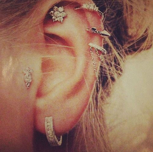 Ear piercings. I love the placement of that flower