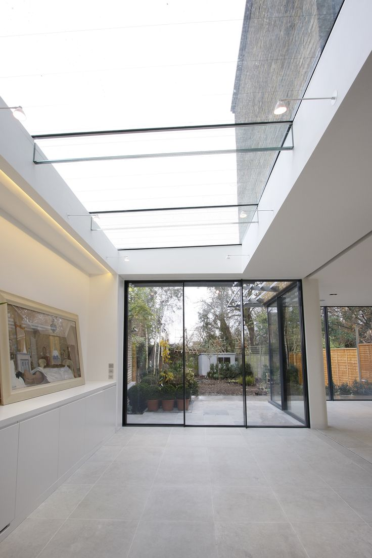 Minimal Windows Sliding Doors and above Structural Glass rooflight on residential property by IQ Glass