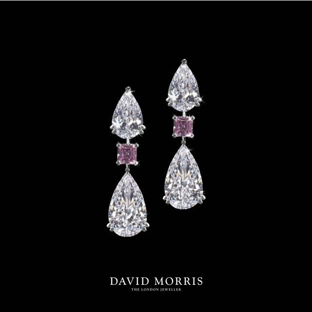 Completing the set, 22.30ct of outstanding brilliance is revealed in this exceptionally beautiful pair of white diamond pear shape earrings with fancy intense pink emerald cut diamonds.
