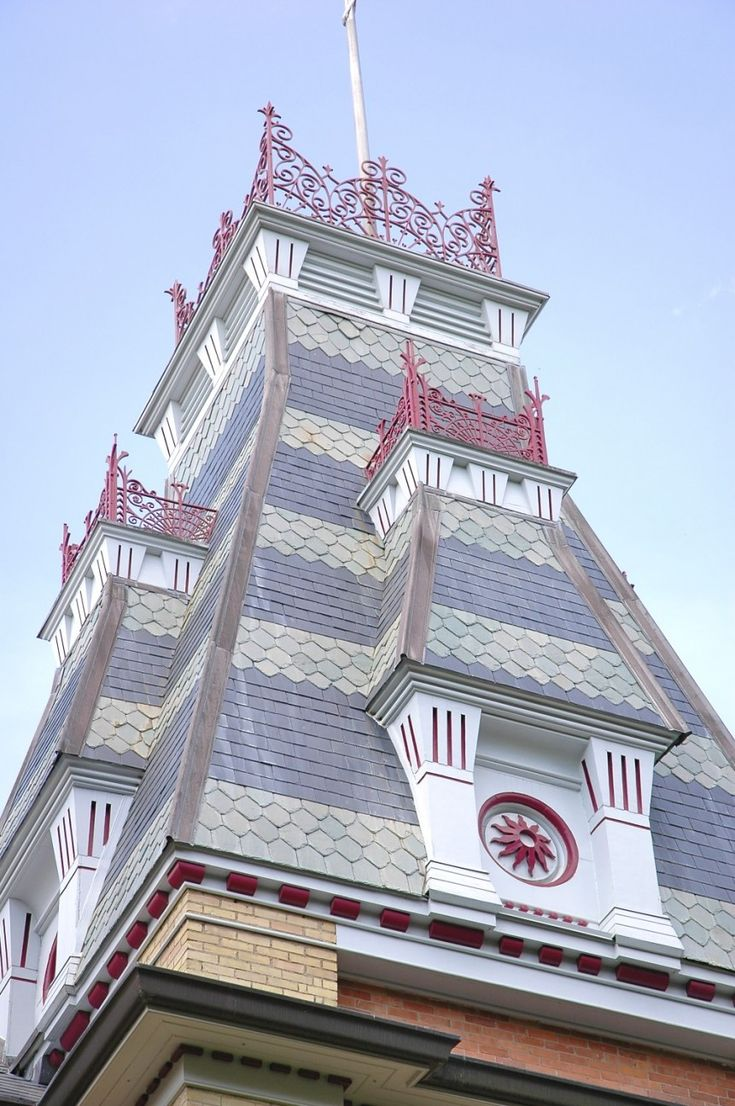 This is one of the 3 projecting towers on top of the Dufferin Court House in Orangeville. The topper of the tower is unique due to its decorative striped fishscale shingles and intricate red iron railings.