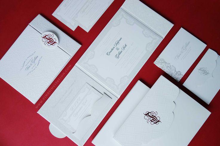 vinas invitation. white embossed. white emboss. emboss invitation. red sign. classic emboss. indonesia wedding invitation. any question pls visit www.vinasinvitation.com . courtesy of Tara and Gilian